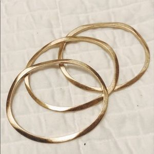 Three gold-toned bangles